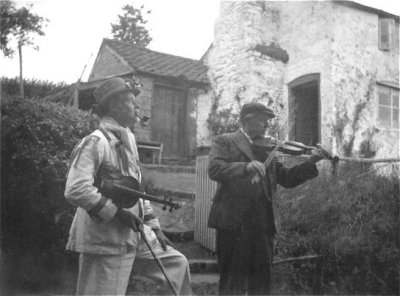 Stephen Baldwin and the Travelling Morrice fiddler (The B M), outside Baldwin's house.