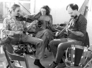 Ken and Jeanie and Mike Doucet playing on Mark and Ann Savoy's porch in 1980 (photo by Ann Savoy)