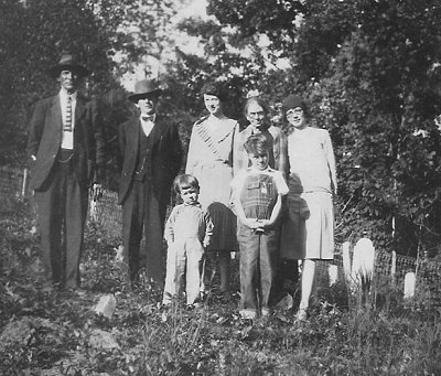 Unknown man.  Jim Ball (husband of Ossie Coates).  Elizabeth Coates (daughter of Eliza Coates).  Eliza Coates.  Ossie Ball, nee Coates (daughter of Eliza Coates).  Unknown children.  c.1933-35.
