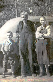 Mrs Minnie Rice (standing on right) with her husband and son